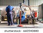 man and robotic machine work... | Shutterstock . vector #660540880