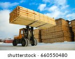 Machine Is Lifting Lumber On A...