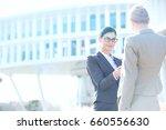 businesswomen shaking hands... | Shutterstock . vector #660556630