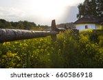 ukrainian village. wooden fence.... | Shutterstock . vector #660586918