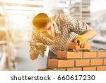 bricklayer. | Shutterstock . vector #660617230