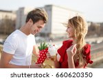 young man give bouquet to woman ... | Shutterstock . vector #660620350