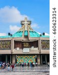 Small photo of MEXICO CITY - JULY 19, 2015: Modern Basilica of Our Mary of Guadalupe (1974). Basilica is one of most important pilgrimage sites of Catholicism, is visited by several million people every year.