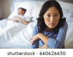 upset woman sitting on bed in... | Shutterstock . vector #660626650