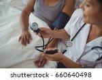 female doctor measuring blood... | Shutterstock . vector #660640498