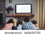 family watching television... | Shutterstock . vector #660654730