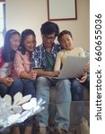 family doing online shopping on ... | Shutterstock . vector #660655036