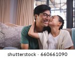 daughter kissing father on... | Shutterstock . vector #660661090