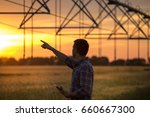 young handsome farmer with...   Shutterstock . vector #660667300