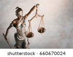 statue of justice on tablet. | Shutterstock . vector #660670024