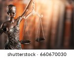 statue of justice and book. | Shutterstock . vector #660670030