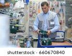 hardware store salesman   Shutterstock . vector #660670840