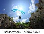 flying above the rocks  parang... | Shutterstock . vector #660677560