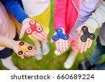four school children playing... | Shutterstock . vector #660689224