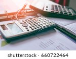 pen with business graphs and... | Shutterstock . vector #660722464