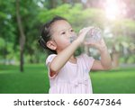 close up little girl drinking... | Shutterstock . vector #660747364
