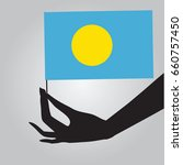 flag of palau in a female hand. ...