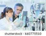 health care researchers working ... | Shutterstock . vector #660775510
