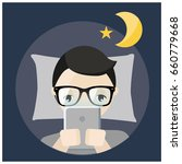 man using tablet before bed... | Shutterstock .eps vector #660779668