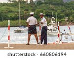 Small photo of Hell-Ville, Madagascar - December 19, 2015: Malagasy Police officers are talking at Hell-Ville port, Nosy Be Island, Madagascar.