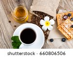 cup of coffee and pastry on... | Shutterstock . vector #660806506