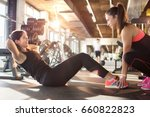 young woman exercising sit ups... | Shutterstock . vector #660822823