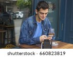 young man with the cellphone in ... | Shutterstock . vector #660823819
