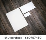 white branding mockup on wooden ... | Shutterstock . vector #660907450