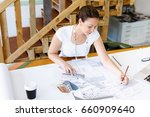 young woman architect in office | Shutterstock . vector #660909640
