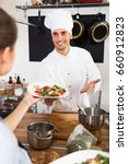 waitress in uniform taking... | Shutterstock . vector #660912823