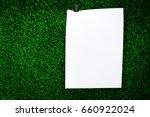 a4 paper on grass | Shutterstock . vector #660922024