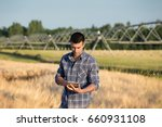 young handsome farmer with... | Shutterstock . vector #660931108