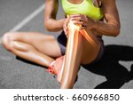 low section of sportswoman... | Shutterstock . vector #660966850