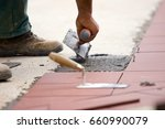 bricklayers at work in a... | Shutterstock . vector #660990079