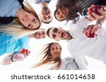 friends congratulate his friend ... | Shutterstock . vector #661014658