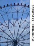 a ferris wheel during a sunny... | Shutterstock . vector #661035898
