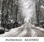 Dirt road and avenue in winter conditions - stock photo
