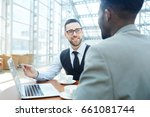 portrait of smiling businessman ... | Shutterstock . vector #661081744