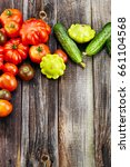 fresh red tomatoes on an old... | Shutterstock . vector #661104568