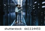 female it technician and male... | Shutterstock . vector #661114453