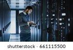 it technician works on laptop... | Shutterstock . vector #661115500