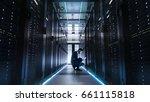 it technician works on laptop... | Shutterstock . vector #661115818