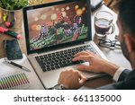 Casino chips on a computer screen. Online gambling concept. Man at work -  - stock photo