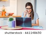 young woman sitting at table on ... | Shutterstock . vector #661148650