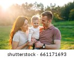 happy young family walking...   Shutterstock . vector #661171693