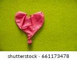 deflated pink red balloon  lie... | Shutterstock . vector #661173478
