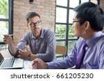 two serious colleagues talking... | Shutterstock . vector #661205230