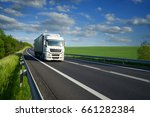 white truck driving on the... | Shutterstock . vector #661282384