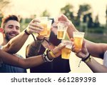 group of friends drinking beers ... | Shutterstock . vector #661289398