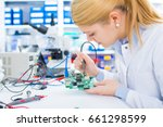 female laboratory assistant... | Shutterstock . vector #661298599